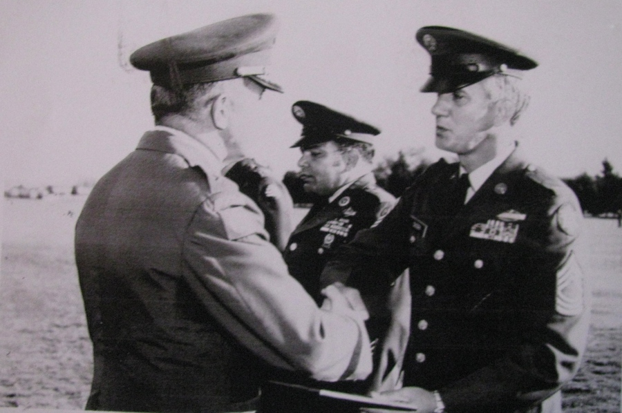 After 20 years of service in the Army Dusek retired a sergeant first class at Fort Lewis, Wash. He is presented his retirement papers by the commanding general of the post in 1971. Photo provided