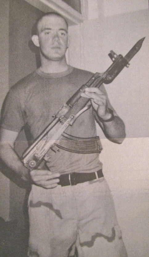 Nethery holds a Russian-designed AK-47 assault rifle. This is the type of rifle with which many of the insurgents are armed in Iraq. Because of its dependibility and fire power, it's one of the most popular rifles ever made. Photo provided