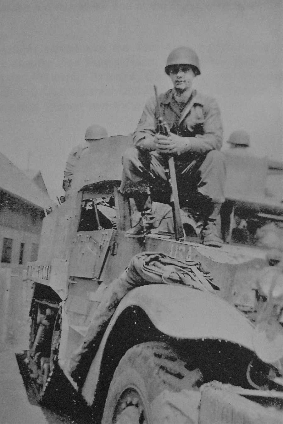 Staff Sgt. Steve Kruger sits on a half-track holding his carbine somewhere in France. He served in Europe during World War II with Gen. George Patton's 3rd Army. Photo provided