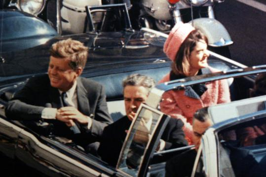 Moments before President John Kennedy was assassinated in Dallas, he and his wife, Jackie, were all smiles as they waved at the adoring crowd that mobbed the curbside during their trip to Dallas, Texas on November 22, 1963.