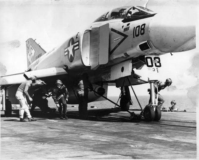 A flight crew works on a Phantom jet fighter on he deck of the USS Independence, an Essex Class carrier Holloway serviced on during the Vietnam War era. Photo provided