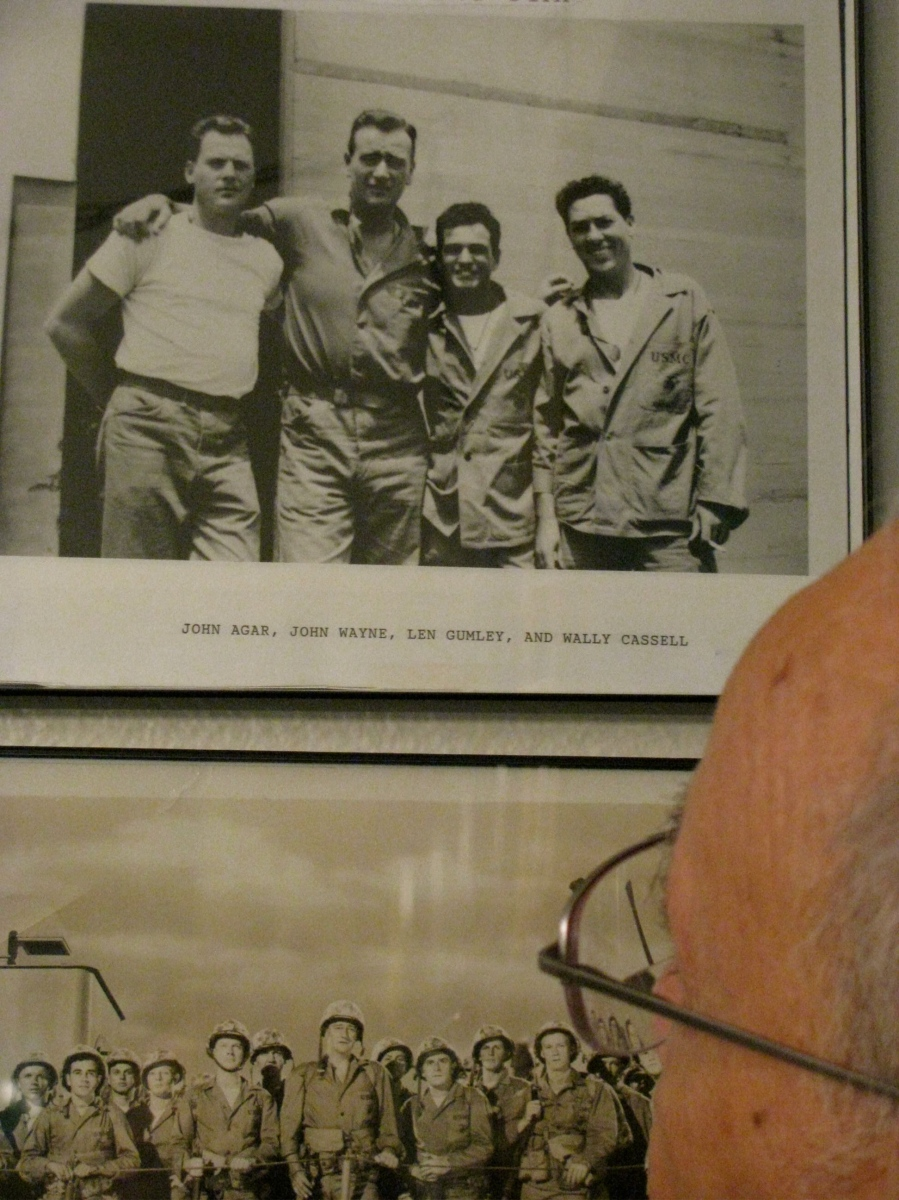 "John Wayne has his left arm around Leon and his right around John Agar. Also in the photo is Wally Cassell on the set of ""Sands of Iwo Jima"" filmed in Hollywood in 1949. Photo provided"