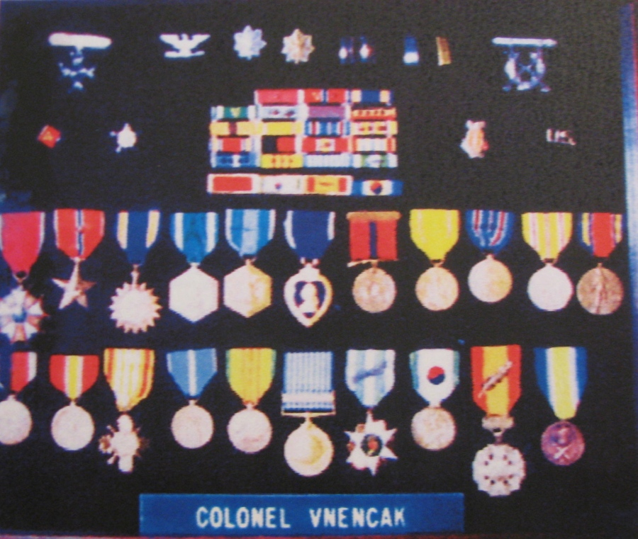 "Col. Paul Vnencak's shadow box contains 23 decorations from World War II, Korea and Vietnam. They include the Purple Heart, two Bronze Stars with ""V"" devices for Valor, Legion of Merit, Air Medal, Navy Commendation Ribbon with ""V"" device for Valor, two Army Commendation medals, Presidential Unit CItation and 15 other decorations. Sun photo by Don Moore"