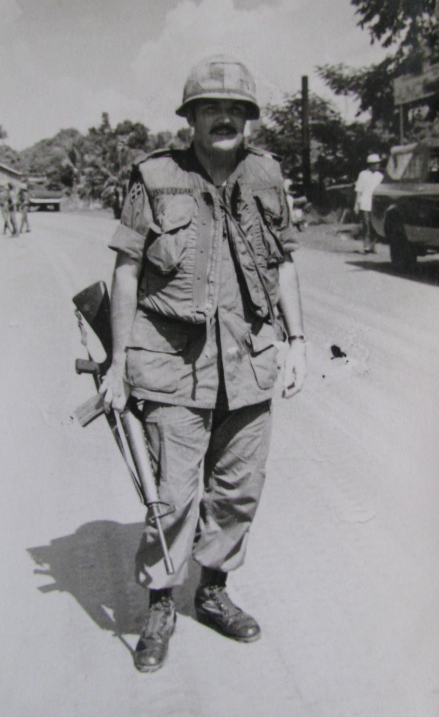 "Maj. Norm Mac Lellan of Venice stands with his M-16 rifle in the middle of Highway One leading north out of Saigon after a firefight with the North Vietnamese Army in 1972. He received a ""Silver Star"" medal for his gallantry. Photo provided"