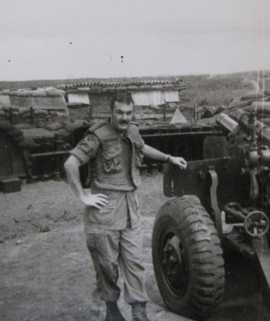 Mac Lellan stands beside an ARVIN canon in 1972 while fighting in the Central Highlands.
