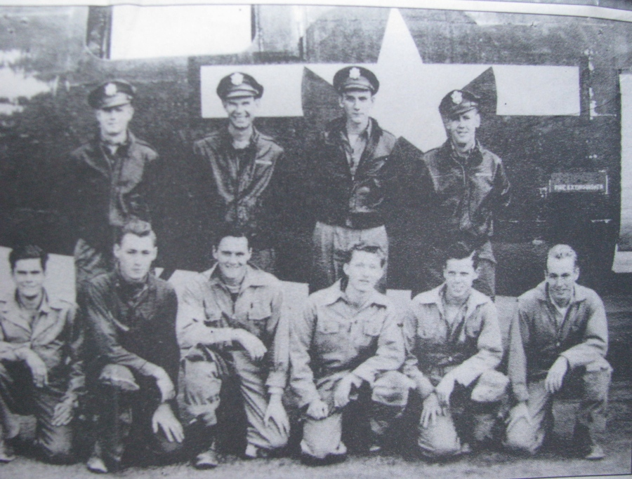 "The crew of ""Lemon Squirt,"" a B-24 heavy bomber that flew in the 15th Air Force in Europe during World War II. Bill Bingham is in the front row squatting third from the left. Photo provided"