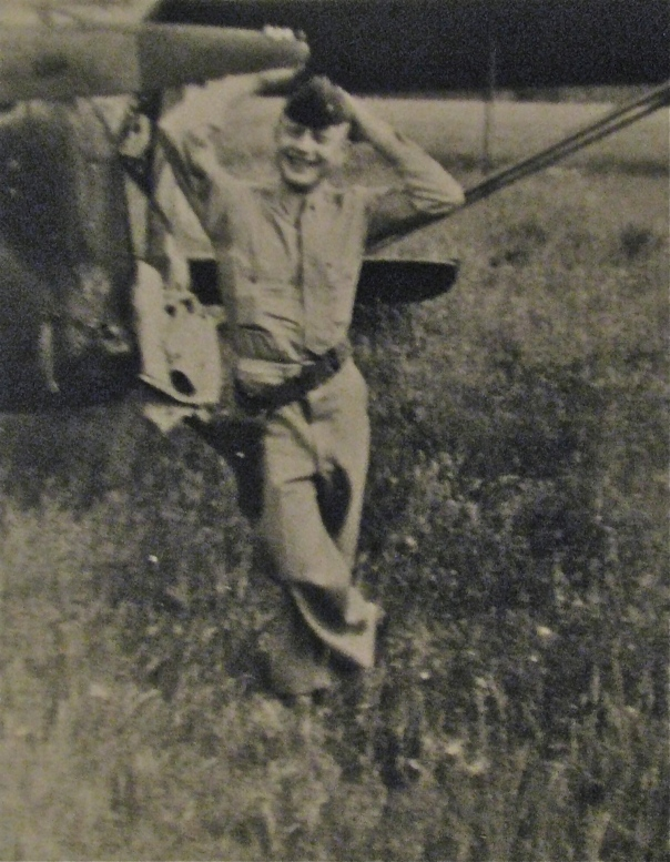 Second Lt. Dave Youngs hams it up for the camera while flying on a patrol with one of the spotter-plane pilots in Austria furing World War II. Photo provided