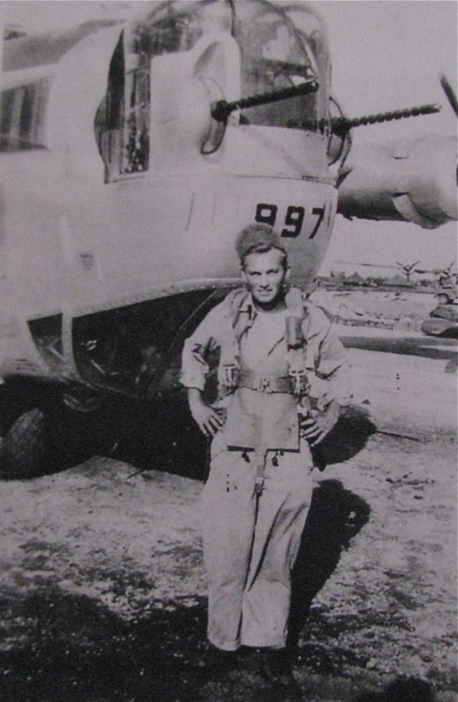 "Sgt. Stowell stands in front of ""Lucky Strike,"" the B-24 four-engine bomber he flew in, somewhere in the Pacific Theatre of Operation six decades ago. Photo provided by Giff Stowell"
