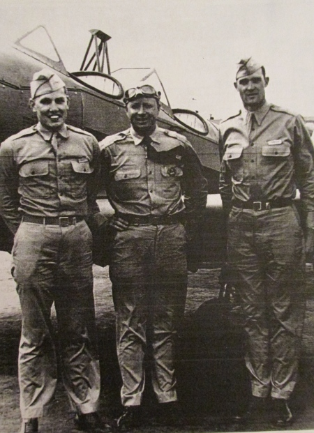 Second Lt. Bill Haase, left, stands in front of a PT-19 biplane with his instructor and another student pilot at an Army airfield near Lubbock, Texas, where he first learned to fly. When this picture was taken he had logged 60 hours of flight time. Photo provided.