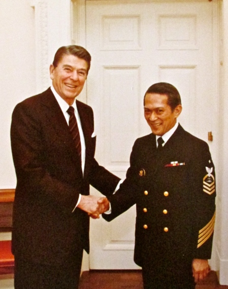 President Ronald Reagan shakes Sanvictores' hand in January 1983. The president had requested he wear his maser chief's Navy uniform for the photo op. Photo provided