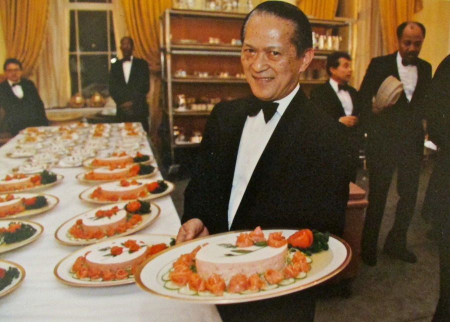 Sanvictores prepares to serve salmon mousse at a formal White House dinner. Photo provided