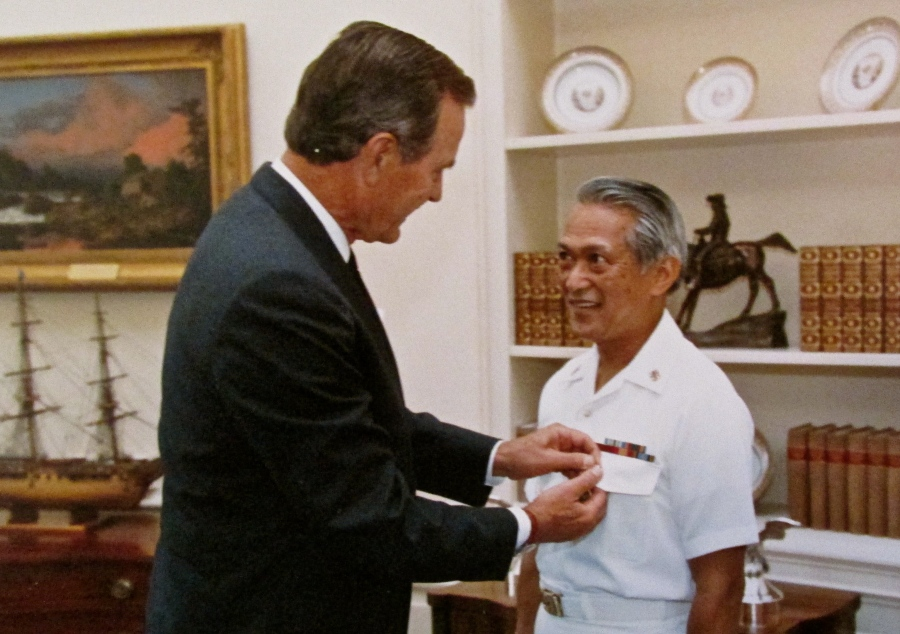 President George H.W. Bush pins a Navy Commendation Medal on Ricardo during a ceremony in the White House in Sept. 5, 1990. Photo provided