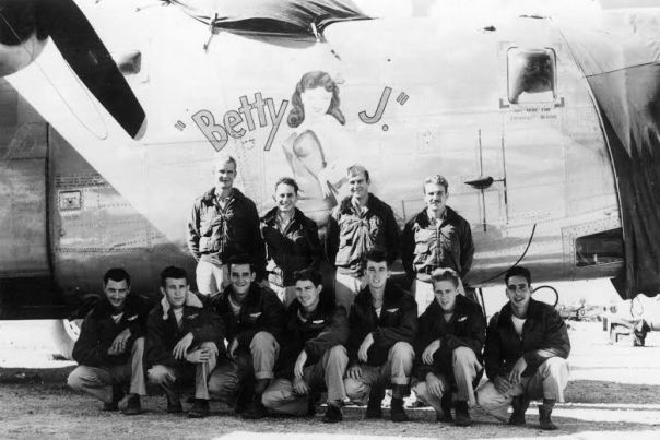 "This is the crew of ""Betty-J"" that includes Staff Sgt. Elbert Bishop of Punta Gorda who served as nose-gunner and radar operator aboard the B-24 ""Liberator."" The crew and the plane were part of the 42nd Bomb Squadron, 11th Bomb Group, 7th Air Force flying out of Tinian and Okinawa during World War II. E M Bishop (standing, 2nd from left) with other crew members standing alongside their plane, the ""Betty J"", a B-24 Liberator aircraft.Photo provided"