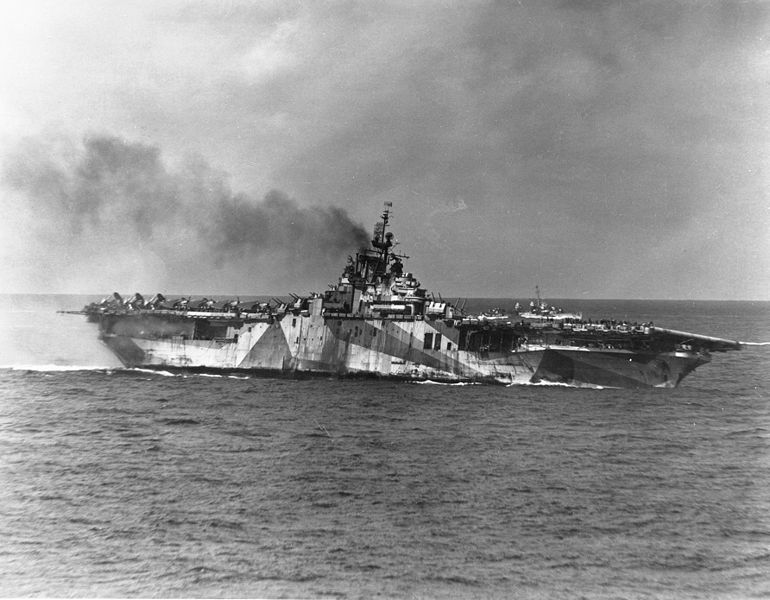 The Ticonderoga is pictured shortly after the Kamikaze attack in the Straits of Formosa in January 1945. The carrier is billowing smoke from the deadly attack. U.S. Navy photo