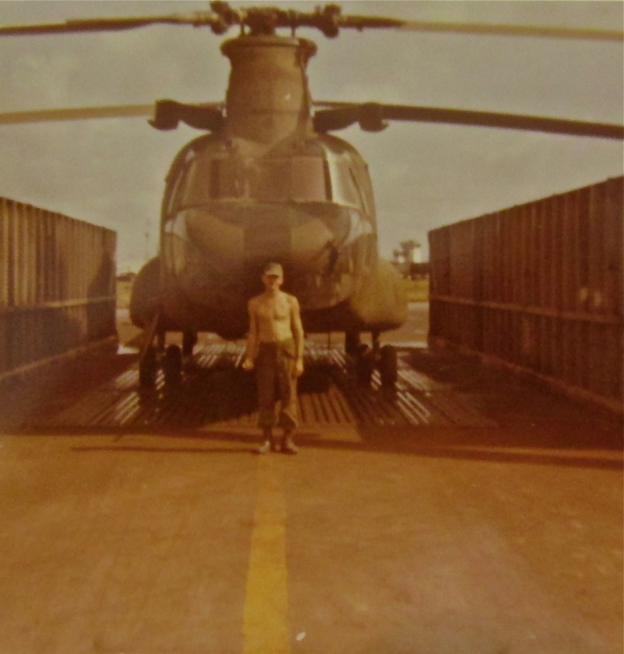 Spc. 5 Stuenkel stands in front of the Chinook CH-47 helicopter he crew-chiefed on in Vietnam in 1970. He served with the 147th Assault Support Helicopter Unit in 'Nam based in Bein Xe Moi in the Delta. Photo provided