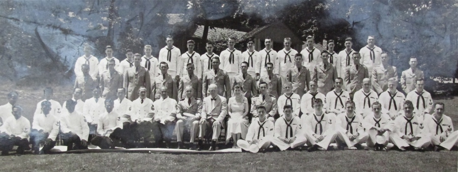 President Dwight Eisenhower (seated front row center) and his White House staff. Goff is pictured in the second row behind the president fifth from the left. Photo provided