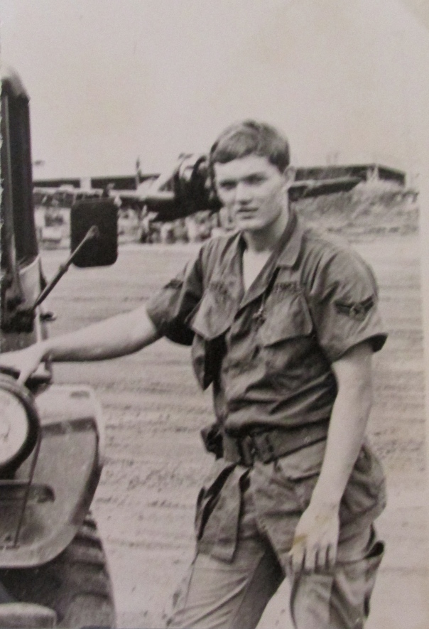 "Airman Jack Freeman of Port Charlotte is pictured with his Jeep along the runway at Bien Hoa Air Force base north of Saigon in 1969 where he worked as weapons specialist. In the background is a Douglas A-1 ""Skyraider."" Photo provide"