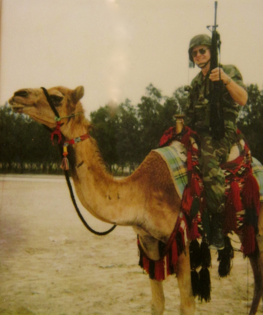 Sgt. Howard Mack astride a camel with his M-16 rifle in Saudi Arabia during 'Desert Storm' in 1990s. Photo provided