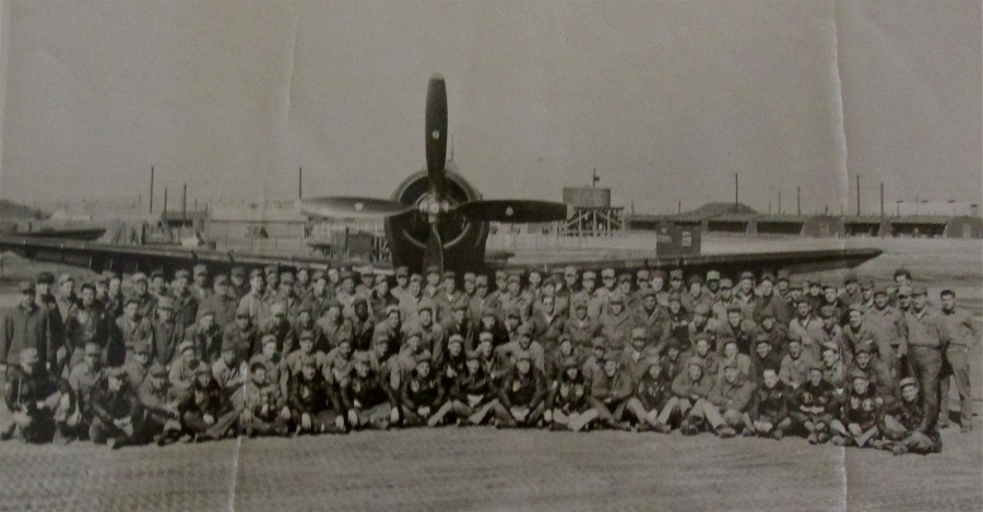 "Cote's entire unit in Korea is pictured grouped around a Douglas A-1 ""Skyraider,"" one of the kinds of planes Cote's repair crew serviced in Korea during the war. Photo provided"