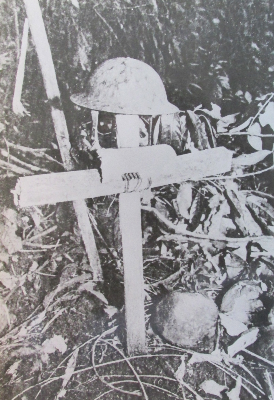 "He also served with the 1st Marine Division during the Battle of Guadalcanal. He was at Henderson Field keeping Douglas SBD Dauntless dive-bombers in the air. The wooden cross and tin helmet is the final resting place of a fellow Marine. On the back side of the picture it reads, 'One of our boy's grave, Guadalcanal 1943."" Photo provided"