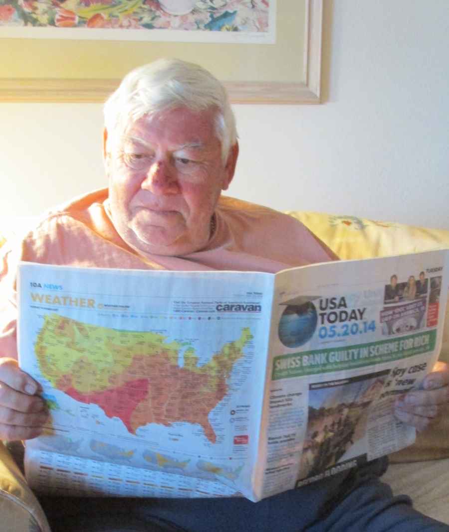 Ed Hutcheson of Burnt Store Marine still keeps of with world events by easing U.S.A. Today. He was once an Air Force intelligence decoder during the 'Cuban Missile Crisis' of the 1960s. Sun photo by Don Moore