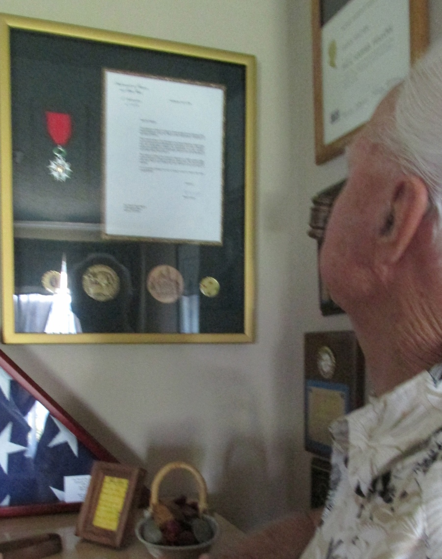 "Magner looks at the French ""Legion of Honour"" the award he received from the French ambassador to the United States after the war for the part he played in the capture of Metz. The award is the highest military honor presented by the French government. Sun photo by Don Moore"