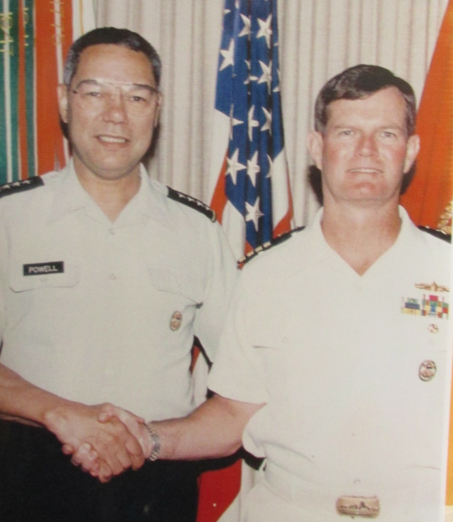 Chairman of the Joint Chiefs Gen. Colin Powell (left) shakes hands with Capt. Glen Berree, Western Hemisphere Branch Chief for the joint chiefs, when they both worked in the Pentagon in 1993. Photo provided