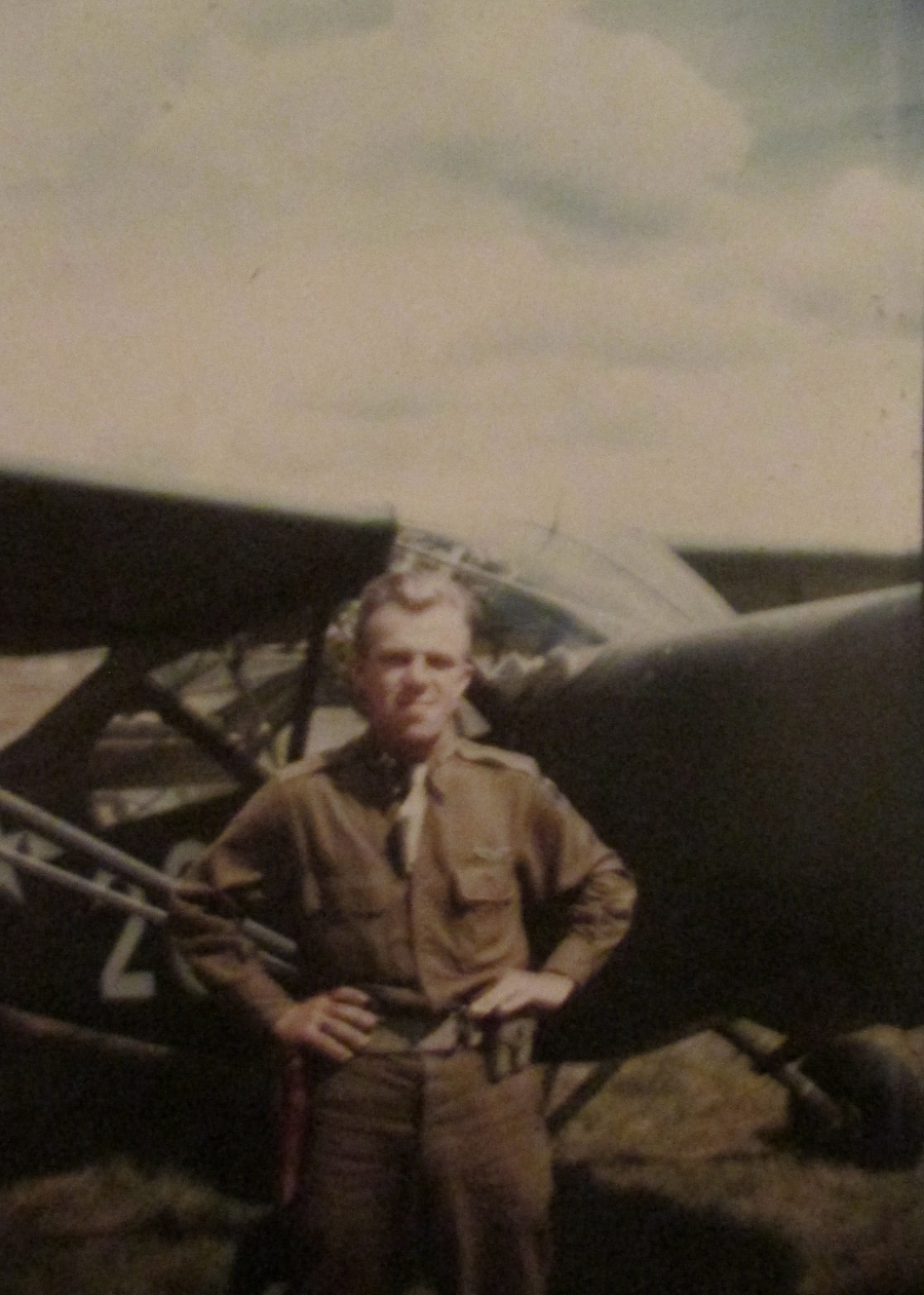 1st Lt. John Johnson stands in front of his L-4 Piper Cub somewhere in Europe during World War II. Photo provided
