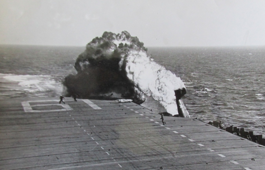 The pilot of this Navy Corsair died in a fiery crash attempting  to land on the deck of the carrier USS John Hancock, CV-19, during a practice session off San Diego at the end of the Second World War.