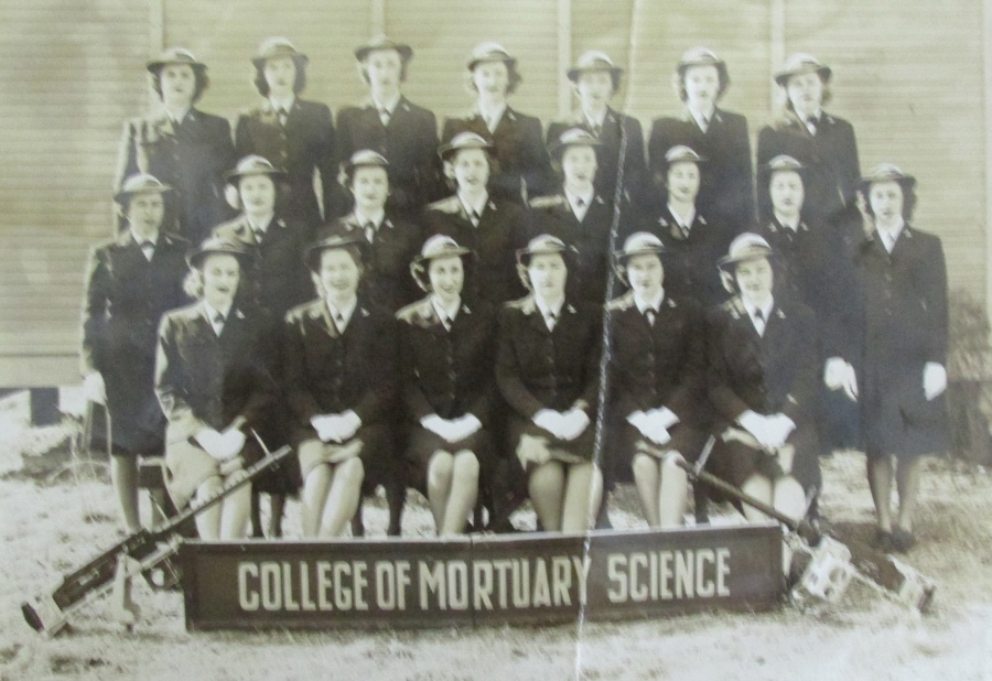 "Scherf was one of the first graduates of the ""College of Mortuary Science"" at Pensacola Naval Air Station. She is the last WAVE at the far right in the second row standing. With their .50 caliber machine-guns they were considered killers. Photo provided"
