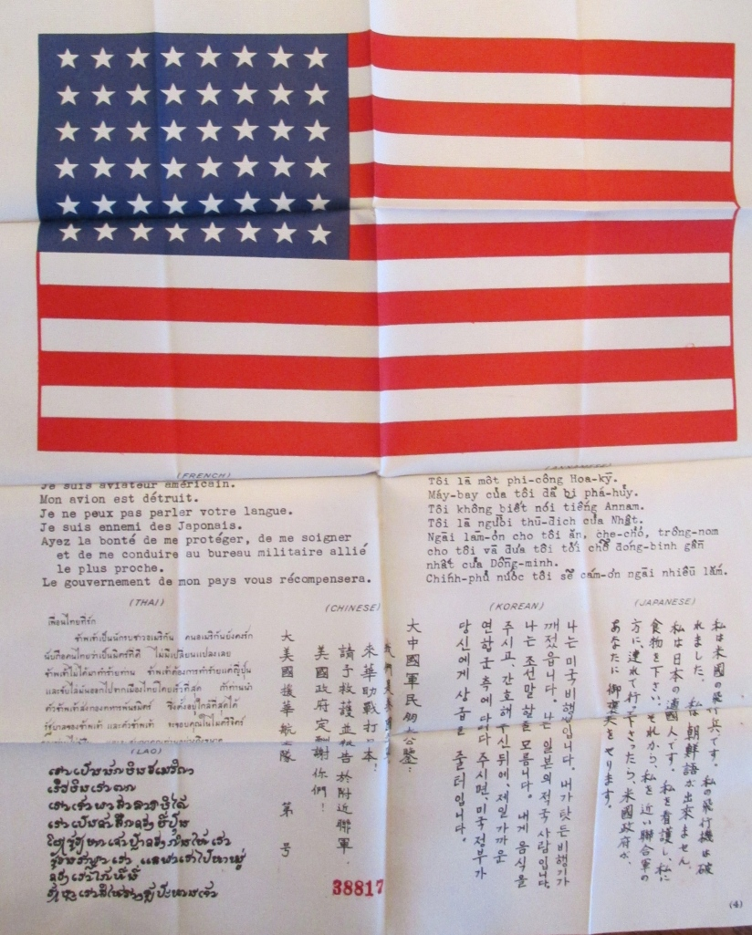 "A ""Blood Chit"" is what they called it. U.S. aviators flew with this American flag with a message in Japanese, Chinese, Lao, Korean and Thai asking that the American with this flag and message be returned to Allied lines. The finder would be paid for his efforts, thus the term ""Blood Chit."" Sun photo by Don Moore"
