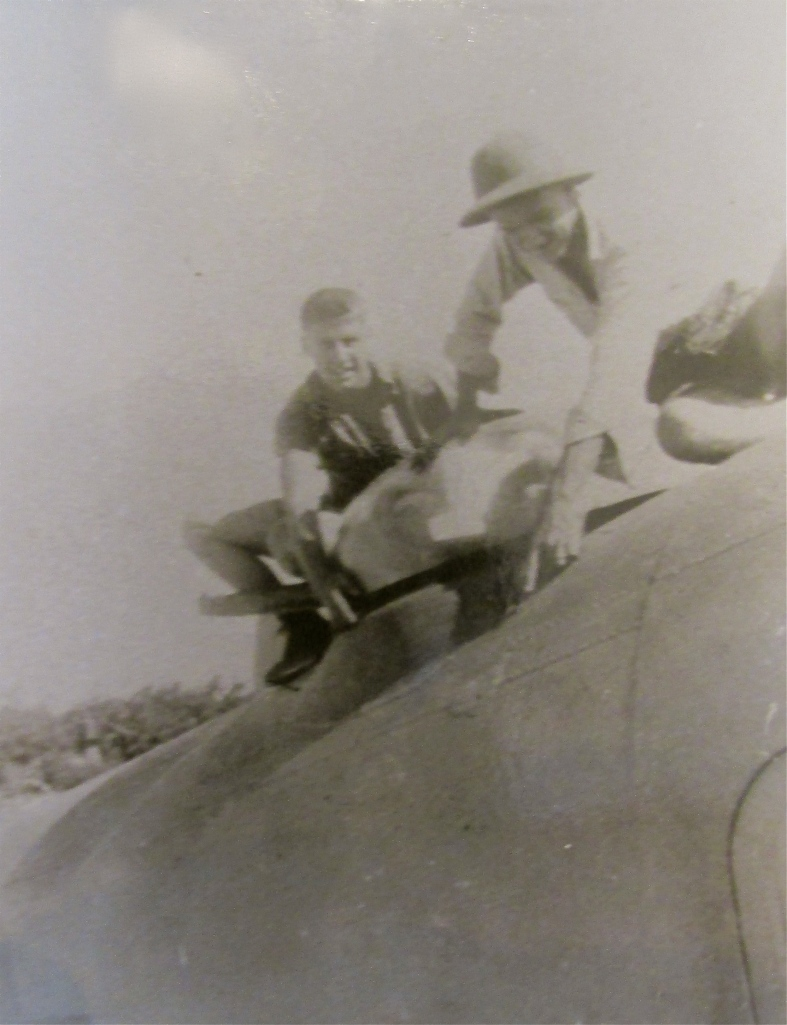 Burdick and a buddy take a look at the 21 enemy bullet holes in the skin of their twin-engine Ventura patrol plane shot up while attacking a Japanese sub and seaplane base on the main islands. Burdick is the one in the background. Photo provided