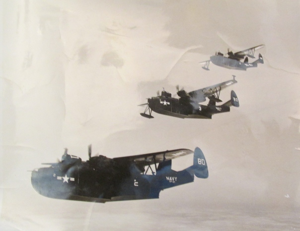 "Like ducks in a row a trio of PBM ""Martin Mariners"" fly over Manila in the Philippines during the Korean War of the 1950s. Dale Davis is at the controls of the last plane. Photo provided"
