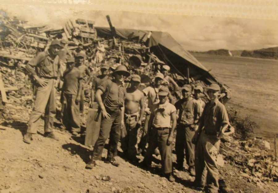 A Japanese POW work detail waits for orders along the side of a road on Saipan. The Seabees used them as construction workers. Photo provided