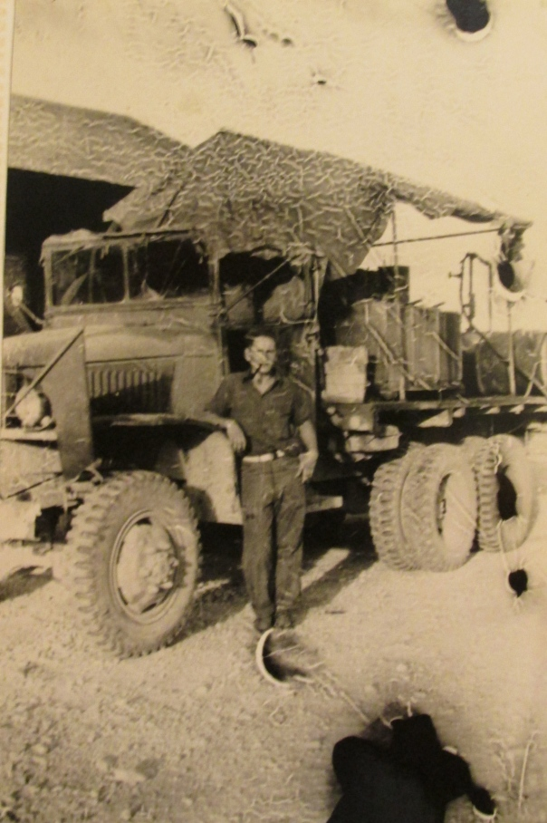 Machinest-mate Warren Hope of Gulf Cove is pictured standing next to an army truck, one of the many constriction vehicles he maintained while serving in the Seabees during World War II. Photo provided