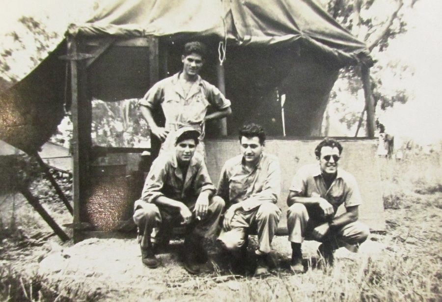 This was Spatharos communications crew when he served in the 89th Bomb Squadron in the Pacific during the Second World War. He's the guy squatting at the far left. Photo provided