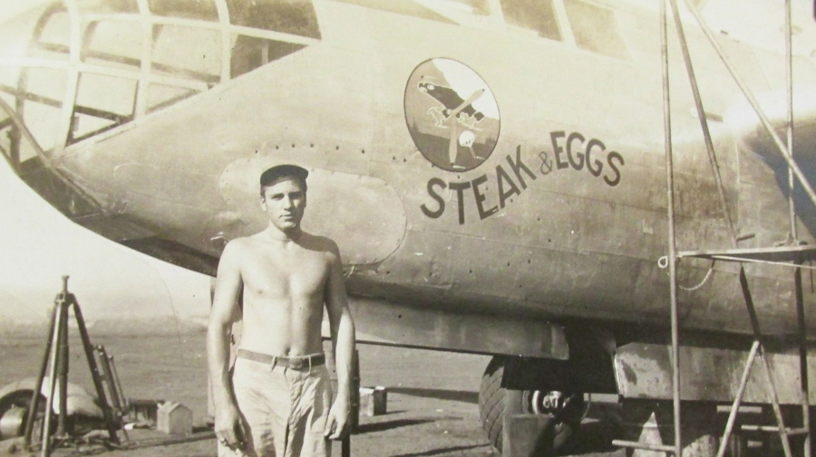 Spatharos stands in front of an A-20 twin-engine bomber named 'Steak and Eggs