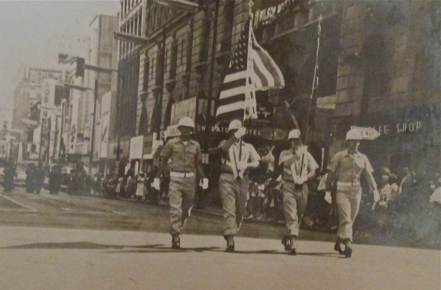 Sgt. Logsdon carries the American flag as part of a color guard in a parade in Louisville, Ky. honoring astronaut Gus Grissom. Photo provided
