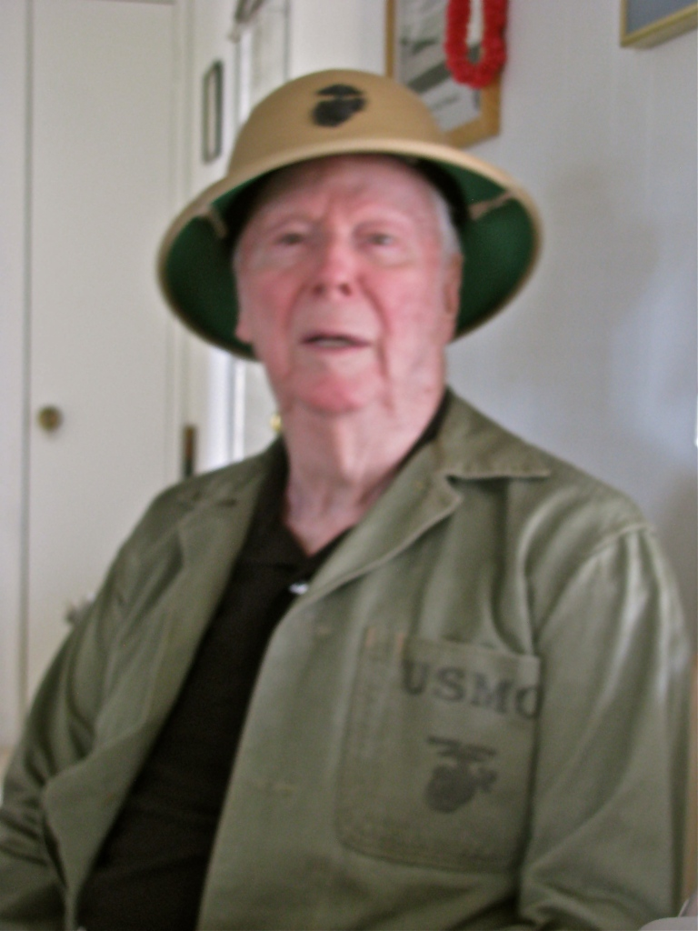 Raymond still has his Marine pith helmet with the Corps' emblem on the front. He can still fit into his green fatigue shirt after all these years even if it's a little tight. Sun photo by Don Moore