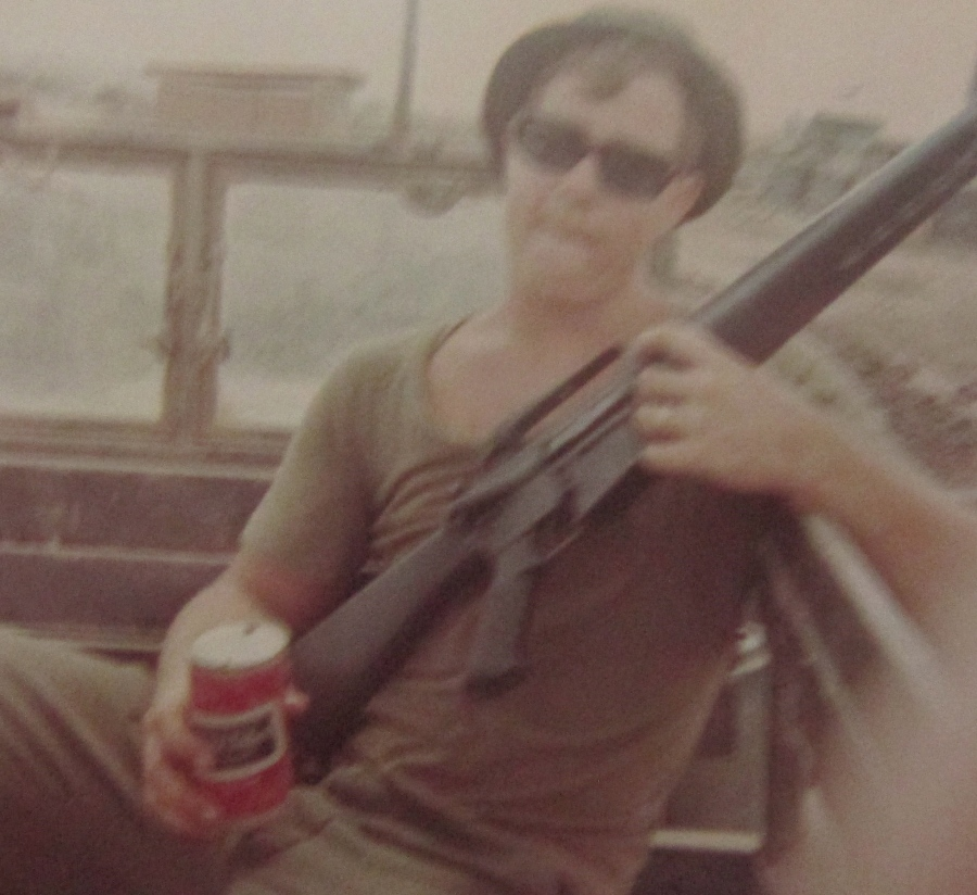 "Spc. 4 Dutch Dutcher hugs his M16 and holds a ""Black Label"" while serving with the 9th Infantry Division as a cook at Dong Tam, Vietnam in the delta country in 1969. Photo provided"