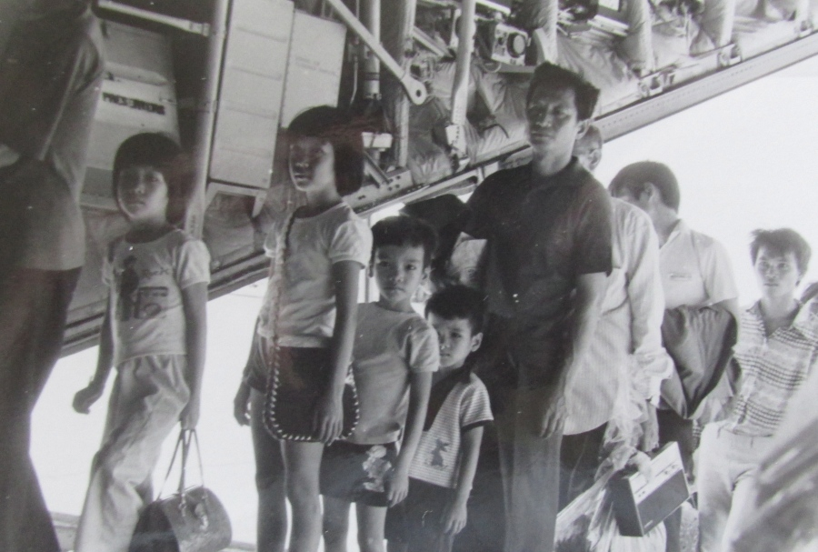 A C-130 transport plane loads Vietnam refugees aboard in April 1975 just before the fall of Saigon Photo provided