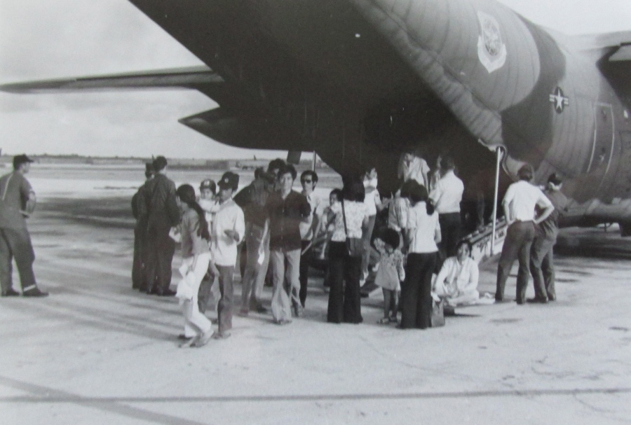 Vietnamese refugees get aboard a C-130 transport during the final days before the fall of Saigon to the North Vietnamese. Lt. Joe Comeaux was involved in flying them to safety in the Philippines. Photo provided