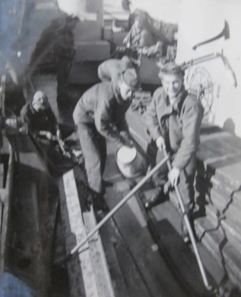 Wyld swabs the deck aboard an LST during one of his two-week summer outings in the Naval Reserve during his four decade career. Photo provided
