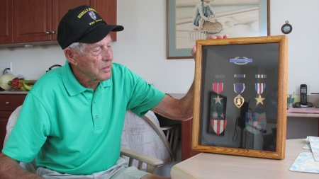 "Gerow is shown with a shadowbox of military medals he received while serving in ""Merrill's Marauders"" during the Second World War. In addition to the Purple Heart he received the Combat Infantryman's Badge, Silver Star and the Bronze Star for valor. His outfit was also awarded the Presidential Unit Citation for the jungle war it fought in Burma against the Japanese. At the bottom is the China, Burma, India shoulder patch and a ""Marauders"" patch. Sun photo by Don Moore"