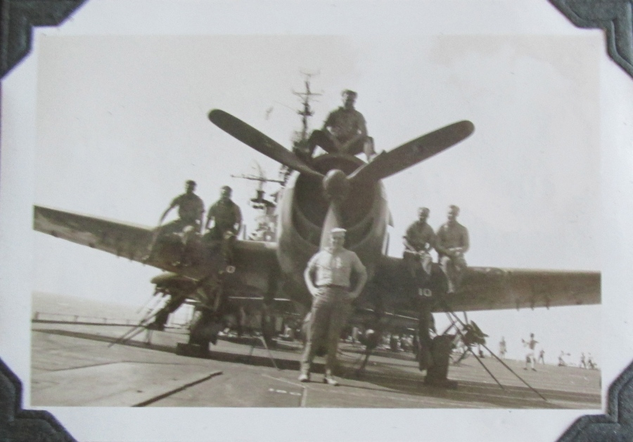 Seaman 1st Class Gene Roaf is pictured standing in front of a fighter on the deck of the carrier USS Bennington possibly off Iwo Jima during World War II. He was a plane captain and maintained a Corsair fighter for a Marine pilot. Photo provided