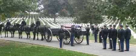 The horse-drawn caisson arrived at former Capt. Harold Sandler's grave site last Tuesday in Arlington National Cemetery outside Washington, D.C. with his honor guard bringing up the rear. In the background a 20-piece military band played funeral music for the occasion. Sun photo by Mary Auenson
