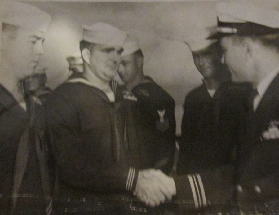 """Lee Mauk receives his submarine pin when he first joined the """"Silent Service"""" as an electrician aboard a diesel sub from World War II. Photo provided"""