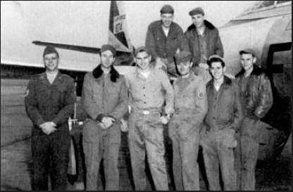 "Doug Danforth is pictured at the far right standing in front of the wing of a F-84 ""Thunderjet"" in Korea during the war in 1950.  Photo provided by Doug Danforth"