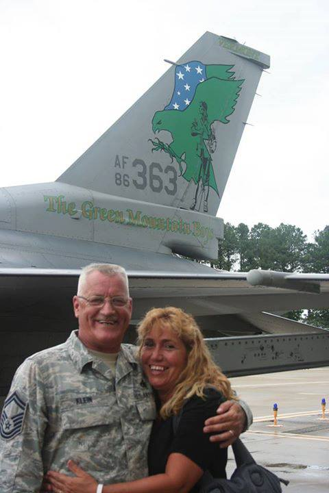 Sgt. Klein and Sharon, his wife, embrace next to an F-16 fighter jet about the time the 158th Fighter Wing was deactivated at Langley Air Fore Base in Virginia in 2013. Photo provided