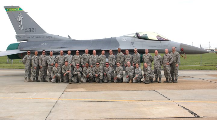 """The Green Mountain Boys,"" the Air National Guard's 158th Fighter Wing from Burlington, Vt.,C stand in front of one of their F-16 ""Falcon"" fighters while on alert at Langley Air Force Base outside Washington, D.C. after ""9-11-2001."" Photo provided"